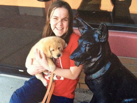Alaina Rudin, 14, holds her new 7-week-old Labrador