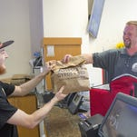 New owners seek revival of restaurant delivery service