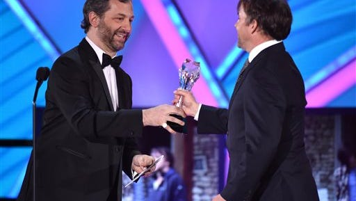 """Judd Apatow, left, presents Richard Linklater with the best director award for """"Boyhood"""" at the 20th annual Critics' Choice Movie Awards at the Hollywood Palladium on Thursday, Jan. 15, 2015, in Los Angeles. (Photo by John Shearer/Invision/AP)"""