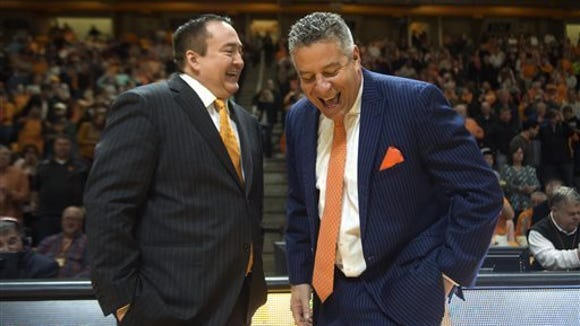 Auburn coach Bruce Pearl shares a laugh with Tennessee coach Donnie Tyndall before Saturday's SEC game in Knoxville
