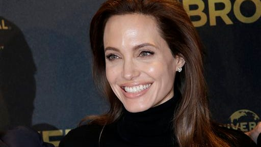 """FILE - In this Nov. 27, 2014 file photo, director Angelina Jolie poses for photographers during a photo call for her film """"Unbroken"""" in Berlin, Germany. Jolie announced in an op-ed in The New York Times on Tuesday, March 24, 2015, that she had her ovaries and fallopian tubes removed to prevent cancer. (AP Photo/Michael Sohn, File)"""