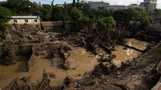 A destroyed flooded zoo area is seen in Tbilisi, Georgia, Monday, June 15, 2015. Rescue workers in the Georgian capital are still searching for at least two dozen people and an undetermined number of potentially dangerous animals missing after severe flooding ravaged the city's zoo. (AP Photo/Pavel Golovkin)