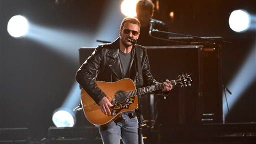 In this Nov. 4, 2015, file photo, Eric Church performs at the 49th annual CMA Awards at the Bridgestone Arena in Nashville. Church and Chris Stapleton lead the early nominees for the 51st annual Academy of Country Music Awards with three nominations each, including male vocalist and album of the year. ACM Awards co-host Dierks Bentley announced the nominees Monday for six categories.