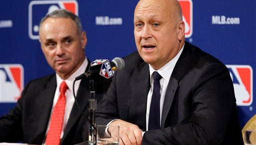 Cal Ripken Jr., right, speaks with Major League Baseball Commissioner Robert D. Manfred, Jr., left, at the MLB winter meetings in 2015 Ripken and his wife Kelly finalized their divorce on Thursday, April 28, 2016.