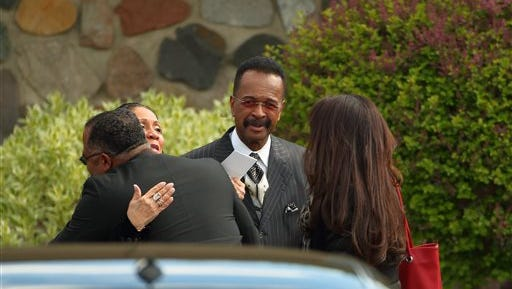 Larry Graham, center, arrive at a Jehovah's Witnesses Kingdom Hall for a memorial service for Prince, Sunday, May 15, 2016, in Minnetonka, Minn. Mourners gathered at Kingdom Hall for a memorial for megastar Prince, who worshipped there before he died last month. (Jeff Wheeler/Star Tribune via AP)  MANDATORY CREDIT; ST. PAUL PIONEER PRESS OUT; MAGS OUT; TWIN CITIES LOCAL TELEVISION OUT