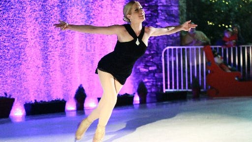 Jaci Boyd of Greenville performs during the 2015 grand opening of the synthetic ice skating rink at Carolina Wren Park in downtown Anderson.