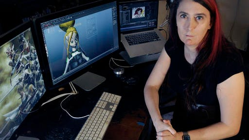 FILE - In this July 25, 2016 file photo Brianna Wu, a software engineer and video-game developer, sits at her workstation in Boston. Wu, the co-founder of a gaming software company who made headlines two years ago when she was threatened, said she wants to run for one of Massachusetts' nine U.S. House seats. Wu said her platform will focus on privacy rights and online harassment. (AP Photo/Elise Amendola, File)
