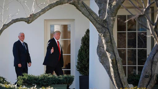 President Donald Trump, accompanied by Vice President Mike Pence, give a 'thumbs-up' as they walk to the Oval Office of the White House in Washington, Wednesday, Jan. 25, 2017, after a visit to the Homeland Security Department. (AP Photo/Pablo Martinez Monsivais)