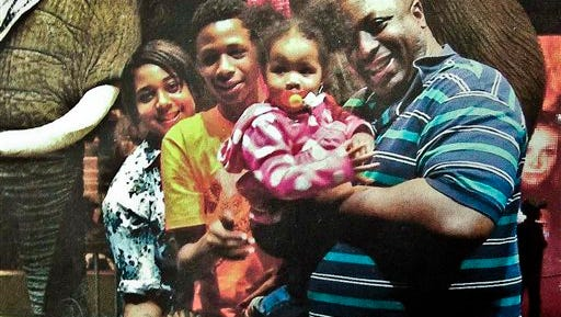 FILE - In this undated family file photo provided by the National Action Network, Eric Garner, right, poses with his children during a family outing.