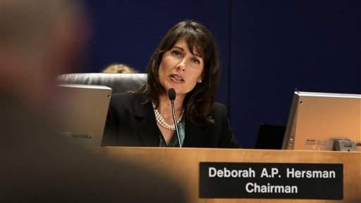National Transportation Safety Board (NTSB) Chair Deborah Hersman speaks during the NTSB board meeting, Monday, Aug. 27, 2012, in Washington, held to determine the probable cause of the accident that occurred during the 2011 National Championship Air Races in Reno on Sept. 16, 2011.