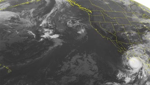 This NOAA satellite image taken Monday, Sept. 15, 2014, at 02:00 AM EDT shows Hurricane Odile making landfall on the Baja Peninsula with maximum sustained winds of 120 miles per hour. Mostly clear skies dominate the western United States because of high pressure systems over the area while scattered precipitation is located east of the Rocky Mountain range. The southwestern United States, including Texas, is receiving scattered showers due to monsoonal flow from Hurricane Odile. (AP Photo/NOAA via Weather Underground)