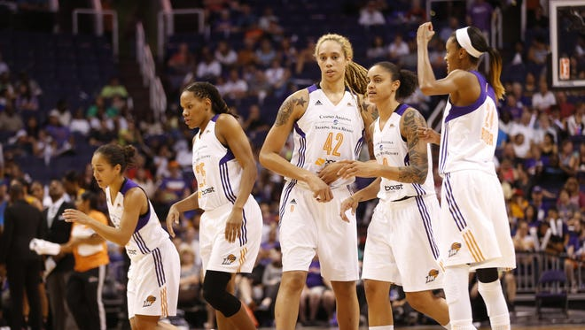 Phoenix Mercury players break a huddle during a break with the Tulsa Shock during the second quarter at US Airways Center in Phoenix, Ariz. August 4, 2015.