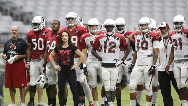 Arizona Cardinals training camp intern coach Dr. Jen Welter watches practice during training camp at University of Phoenix Stadium in Glendale August 26, 2015.