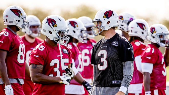 Carson Palmer, 3, leads the troops during practice at the Arizona Cardinals Tempe facility, Tuesday, May 17, 2016.