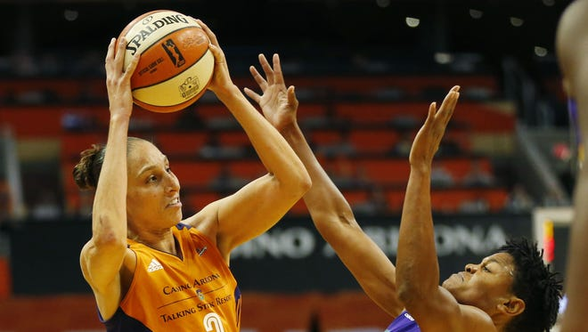 Phoenix Mercury guard Diana Taurasi (3) looks to pass while defended by Los Angeles Sparks forward Alana Beard (0) in the first quarter during WNBA playoff semifinals game 3 at Talking Stick Resort Arena in Phoenix, Ariz. September 17, 2017.