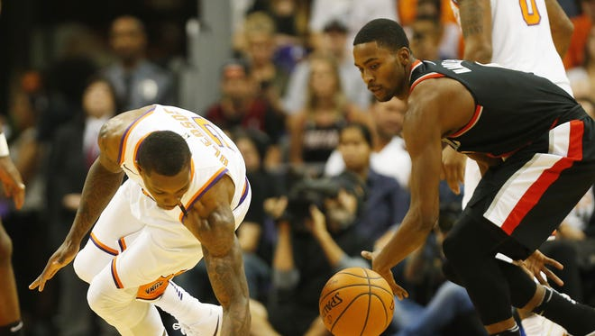 Phoenix Suns guard Eric Bledsoe (2) loses the ball in front of Portland Trail Blazers forward Maurice Harkless (4) during the first quarter at Talking Stick Resort Arena October 18, 2017.