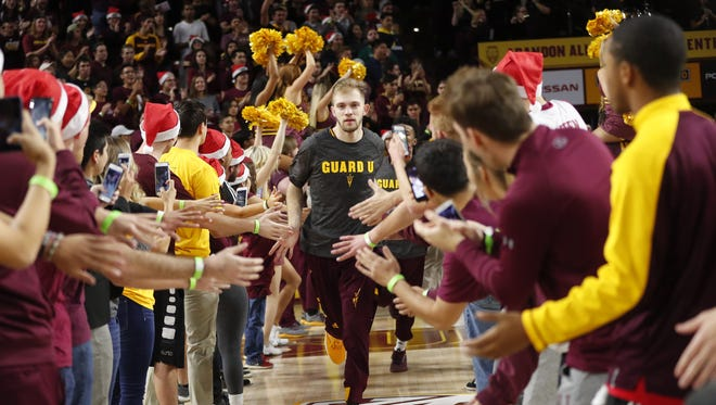 Arizona State guard Kodi Justice (44) runs out with his team before playing against Vanderbilt at Wells Fargo Arena in Tempe, Ariz. December 17, 2017.