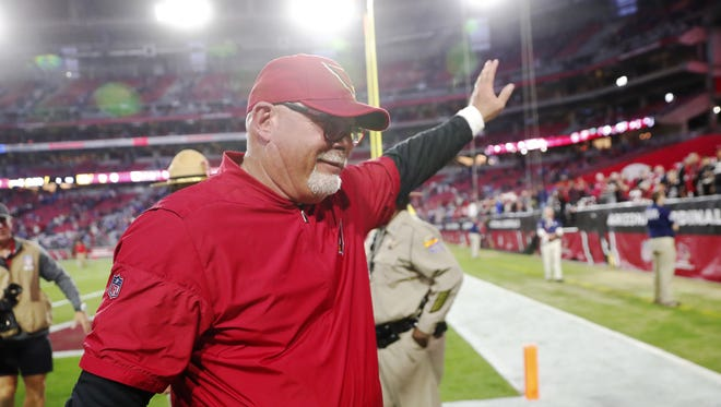 Arizona Cardinals head coach Bruce Arians waves to fans after beating the New York Giants 23-0  at University of Phoenix Stadium in Glendale, Ariz. December 24, 2017.