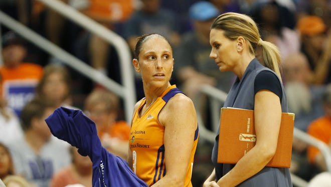 Phoenix Mercury guard Diana Taurasi (3) looks towards the court while standing next to director of player development/performance coach and wife Penny Taylor during WNBA playoff semifinals game 3 against the Los Angeles Sparks at Talking Stick Resort Arena in Phoenix, Ariz. September 17, 2017.