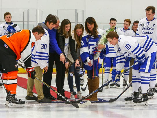 The two teams dropped a ceremonial first puck in memory