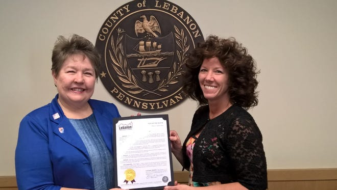 Business Women's Day is Sept. 22. Receiving a proclamation from Mayor Sherry Capello in honor of the occasion is Jo Ellen Litz, a 25-year member of the Lebanon Valley Charter Chapter of the American Business Women's Association and the ABWAs vice president.