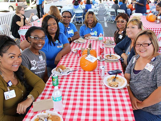 Employees enjoy lunch at OneFest, an employee appreciation