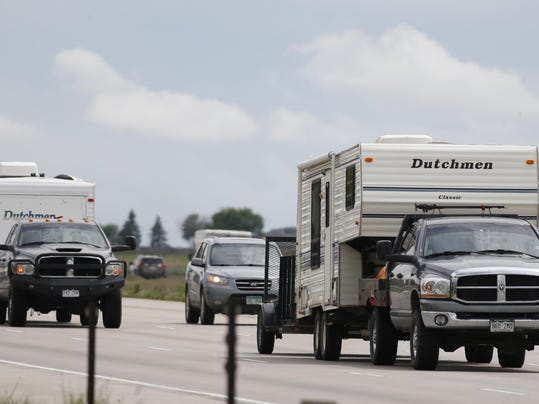 Motorists with campers on Interstate 25