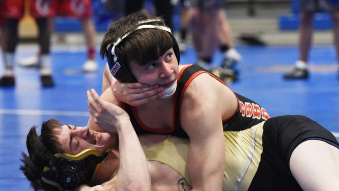 Coshocton's Lucian Brinks competes in the ECOL tournament last month. Brink, a 106-pound wrestler, enters the Division III state tournament at 43-0.