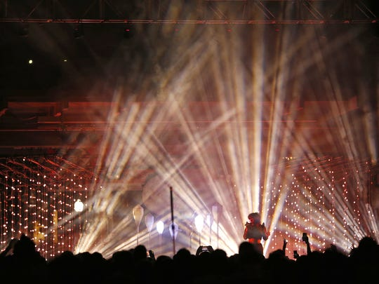 Purity Ring, a Canadian electronic music duo, performs