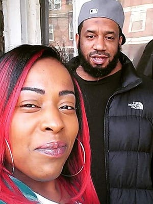 Tiffany Smith poses for a photo with her friend Antoine Perkins, who was killed in December.