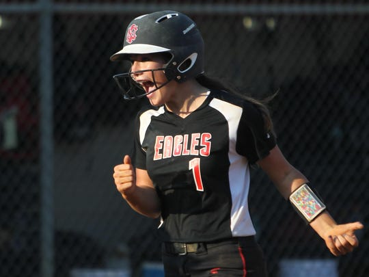 NFC's Chloe Culp celebrates hitting a game-tying 3-run home run against Maclay in the bottom of the seventh inning during their District 1-3A championship game Friday.