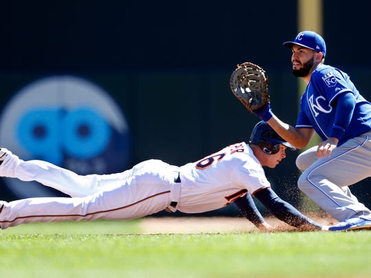 Minnesota Twins' Max Kepler, left, beats the throw to Kansas City Royals first baseman Eric Hosmer as he dives back to first base in the third inning of a baseball game Thursday, April 6, 2017, in Minneapolis.