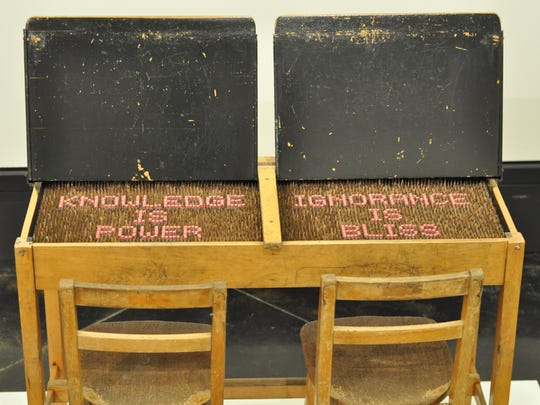 Artist John Salvest used vintage school desks and pencils to create this piece. Some of his work, which often incorporates words, is on display at the Alexandria Museum of Art through May 21.