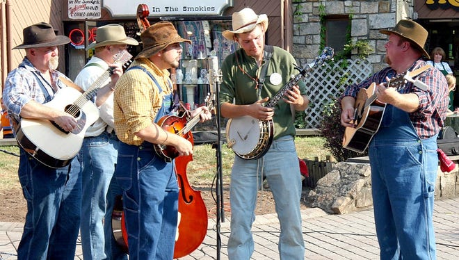 Smoky Mountain Tunes & Tales performers play music on the streets of Gatlinburg.