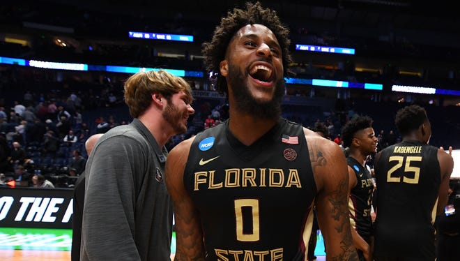Mar 18, 2018; Nashville, TN, USA; Florida State Seminoles forward Phil Cofer (0) celebrates after defeating the Xavier Musketeers in the second round of the 2018 NCAA Tournament at Bridgestone Arena. Mandatory Credit: Christopher Hanewinckel-USA TODAY Sports