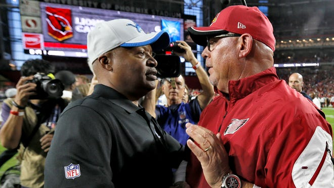 Arizona Cardinals coach Bruce Arians, right, greets Detroit Lions head coach Jim Caldwell after the Cardinals won, 14-6, Nov. 16, 2014 in Glendale, Ariz.