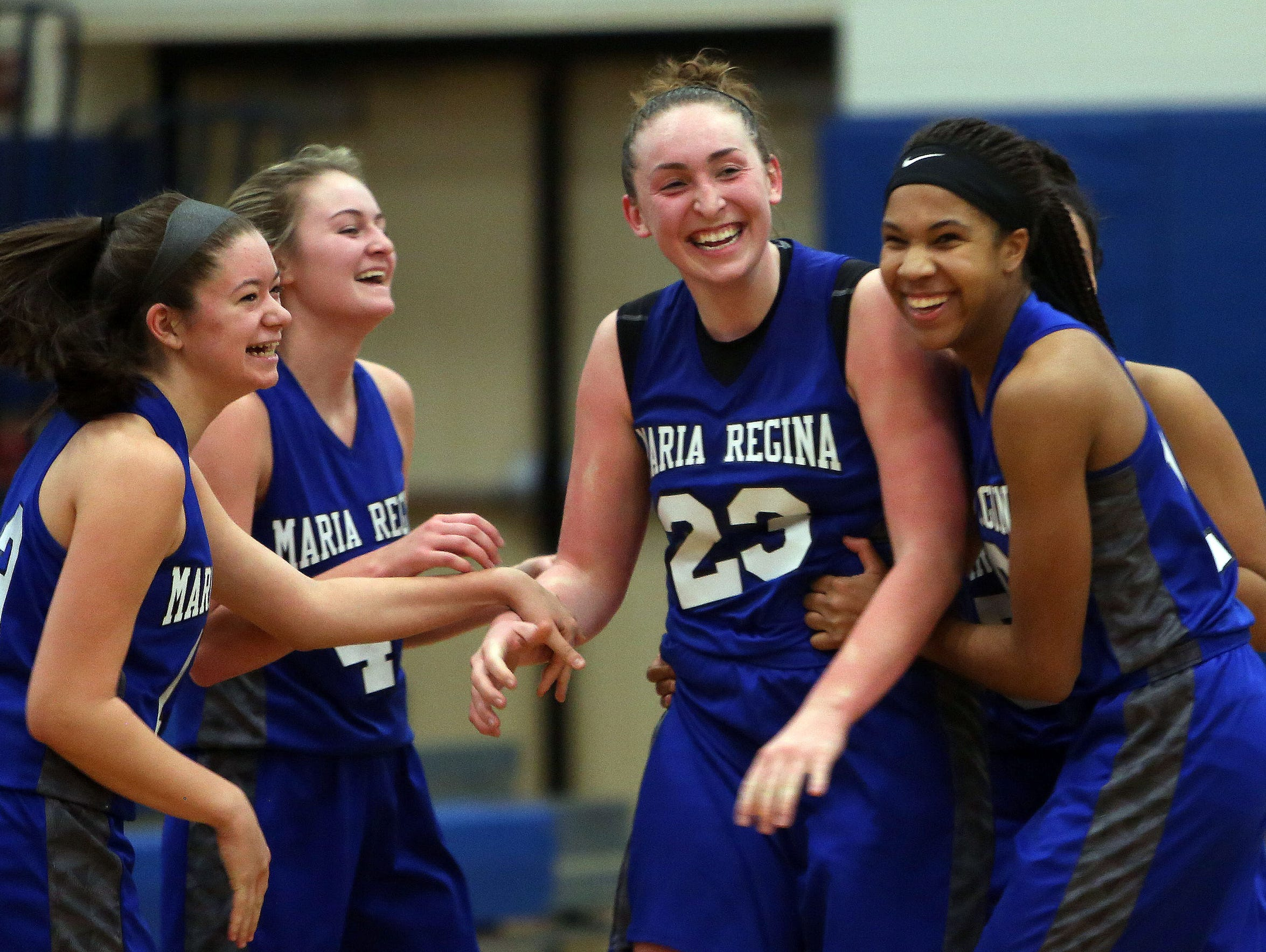 Maria Regina's Kaitlyn Downey (23) is mobbed by teammates