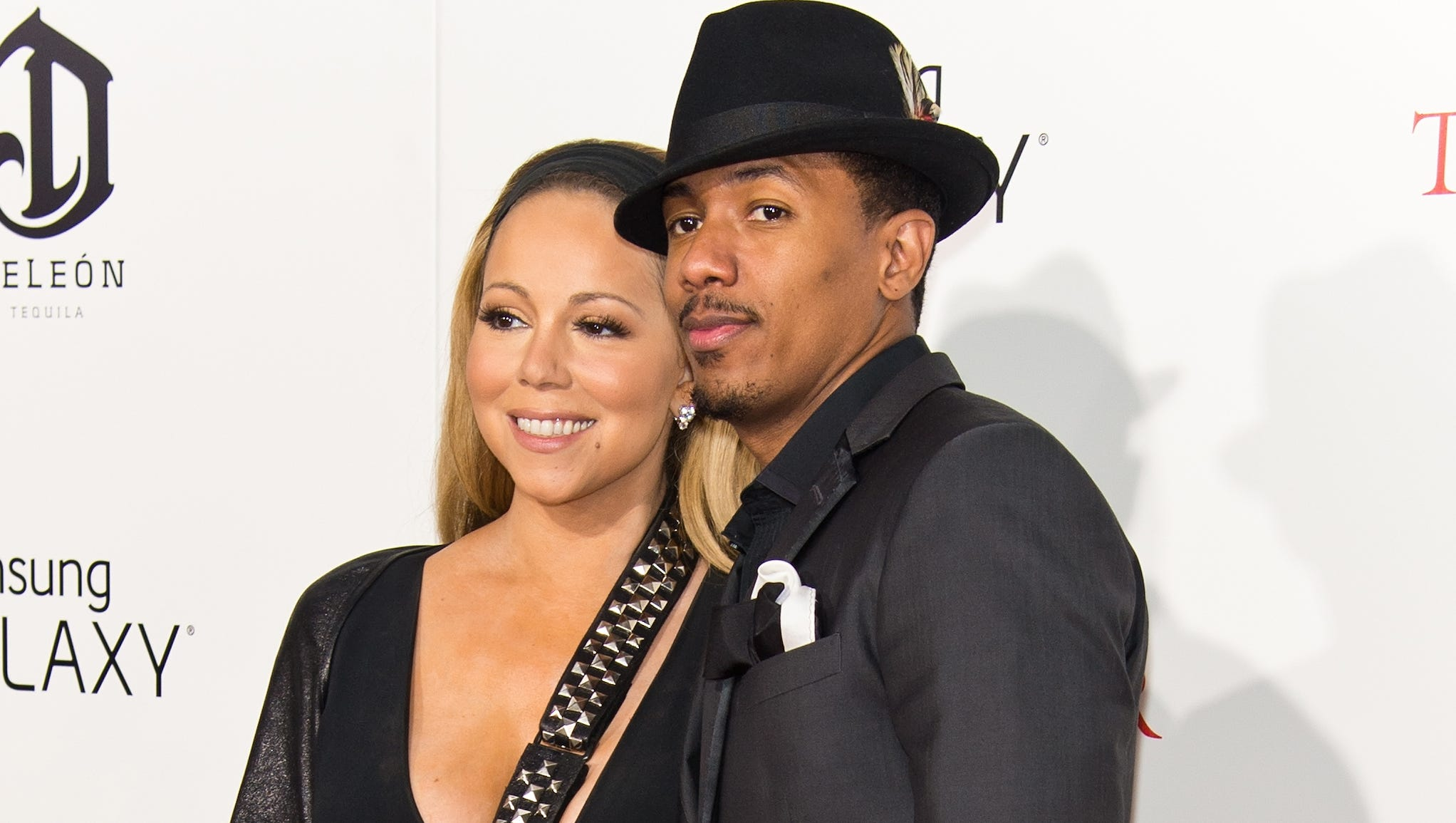 """Carey showed off her black studded sling with husband Nick Cannon by her side on Aug. 5. The couple spent their date night at 'The Butler' premiere in NYC. Cannon actually directed the video shoot where Carey was injured. """"It was pretty serious,"""" Cannon said on the 'Today' show. """"Not only did she dislocate her shoulder, she actually cracked a rib and ... she chipped her shoulder bone."""""""