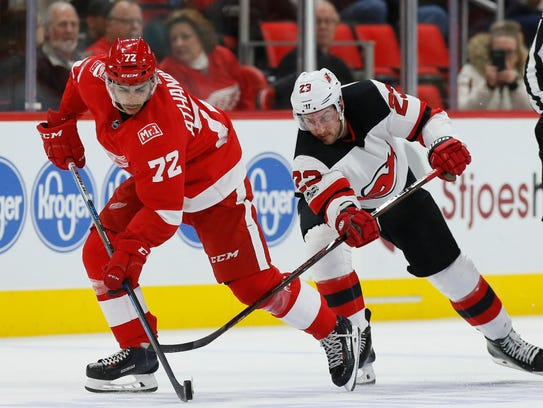 Andreas Athanasiou tries to ward off Devils right wing Stefan Noesen on Saturday.