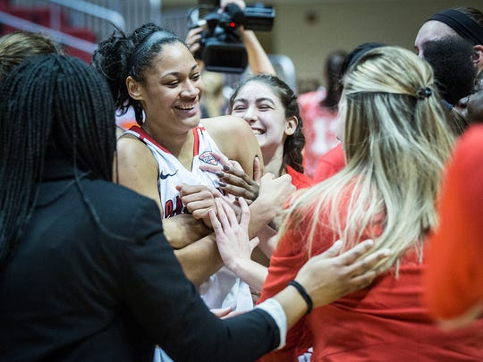 Ball State's Nathalie Fontaine celebrates with teammates after breaking the school's all-time scoring record during their game against Northern Illinois Wednesday, March 2, 2016.