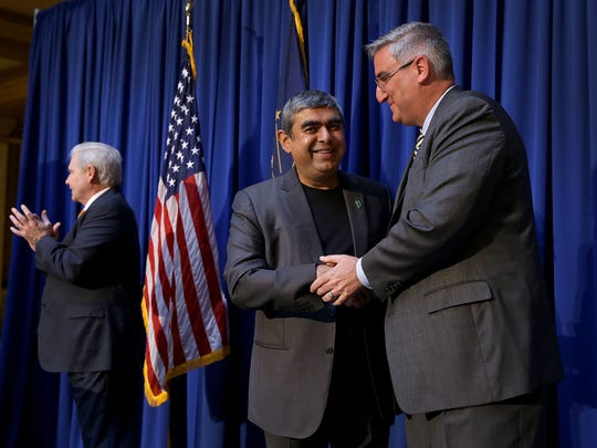 Governor Eric Holcomb,right, and Infosys CEO Dr. Vishal Sikka announce his company to bring 2000, high-skilled high tech to central Indiana by the end of 2021Tuesday. May 2, 2017, at the Indiana Statehouse.