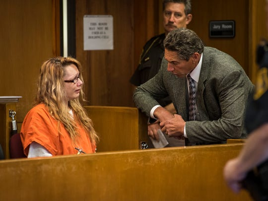Theresa Marie Gafken, left, speaks with her lawyer, Edward Marshall, in Judge John Monaghan's courtroom in Port Huron before her motion hearing Tuesday, May 22, 2018. Gafken, 35, of Port Huron, is being charged with second-degree murder for the April 11 car crash that killed a 48-year-old Chesterfield woman.