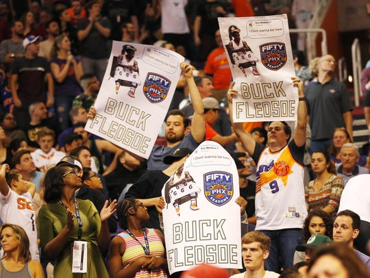 Fans hold signs for Milwaukee Bucks guard Eric Bledsoe