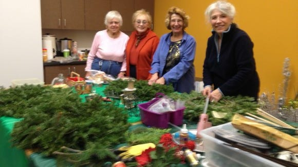 Carroll Manning, Judy Mutrie, Elaine McGrady and Margie Cress decorating wreaths in an image from two years ago. (Provided photo)