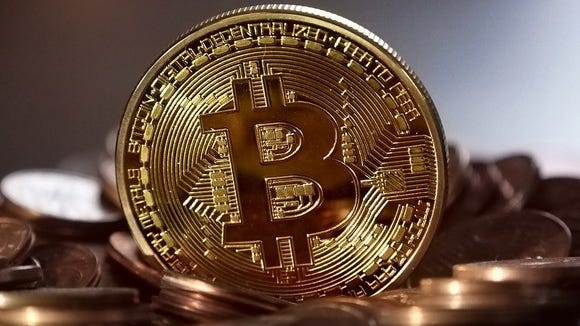 To be clear, there is no physical manifestation of a bitcoin that looks like this; it is a digital currency.