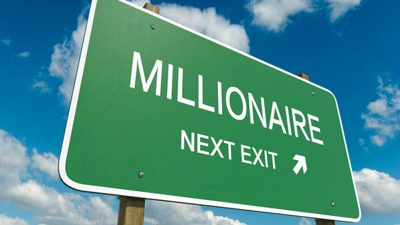 "Road sign that says ""Millionaire: next exit"""