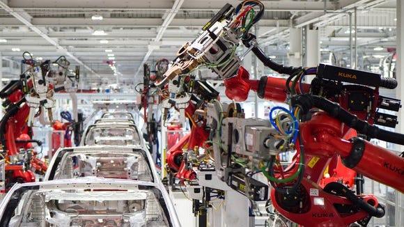Tesla vehicle production line.