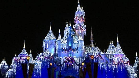 Disneyland castle lit up at night.