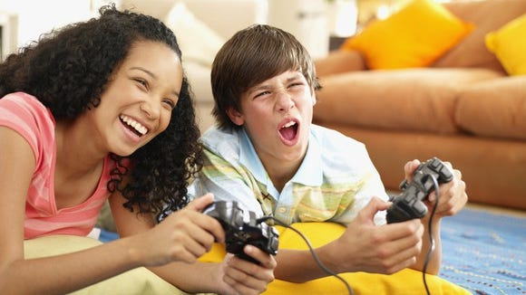 Kids playing console games.