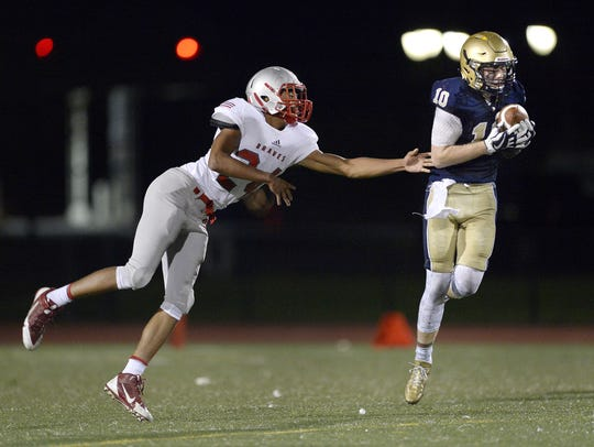 Brighton's Shea McDonald, right, intercepts a pass